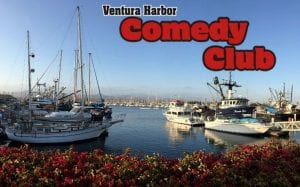 Ventura Harbor Comedy Club overlaying a beautiful photo of the harbor with clear blue waters and boats docked