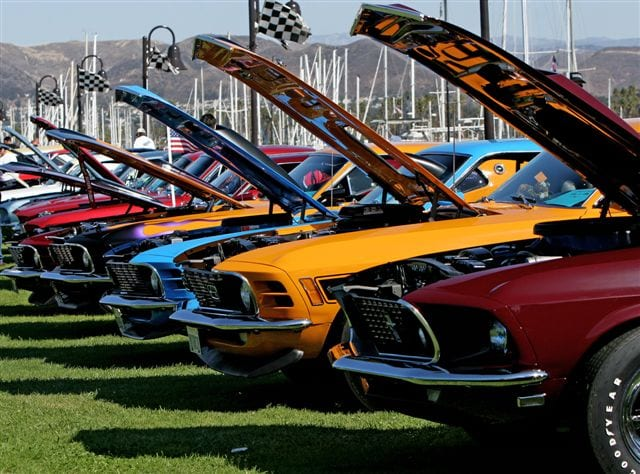 Classic mustangs lined up along the seaside at Ventura Harbor Village