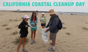Volunteers doing their part in participating in a coastal clean up, picking up any debris and trash to conserve the beauty in California beaches