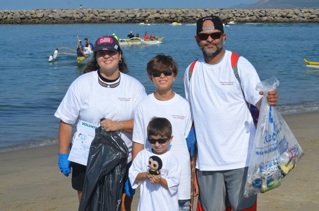 family participating in coastal clean up at harbor cove beach