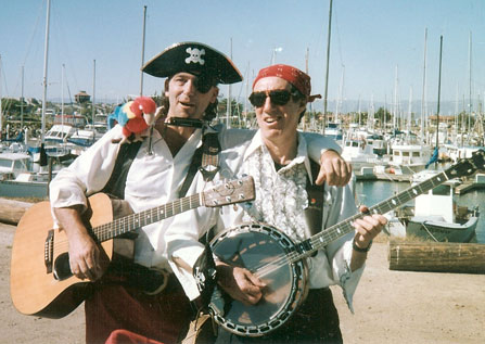 Steve Stafford dressed as a pirate playing his guitar