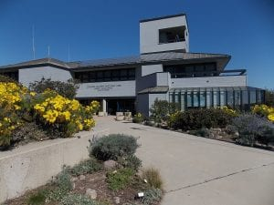 The Channel Islands National Parks Visitor Center surrounded by wildflowers on the waterfront in Ventura Harbor