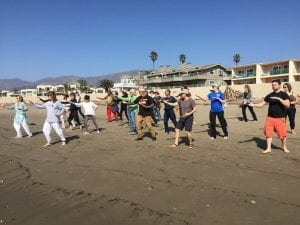 Tai Chi Class being held on the beach