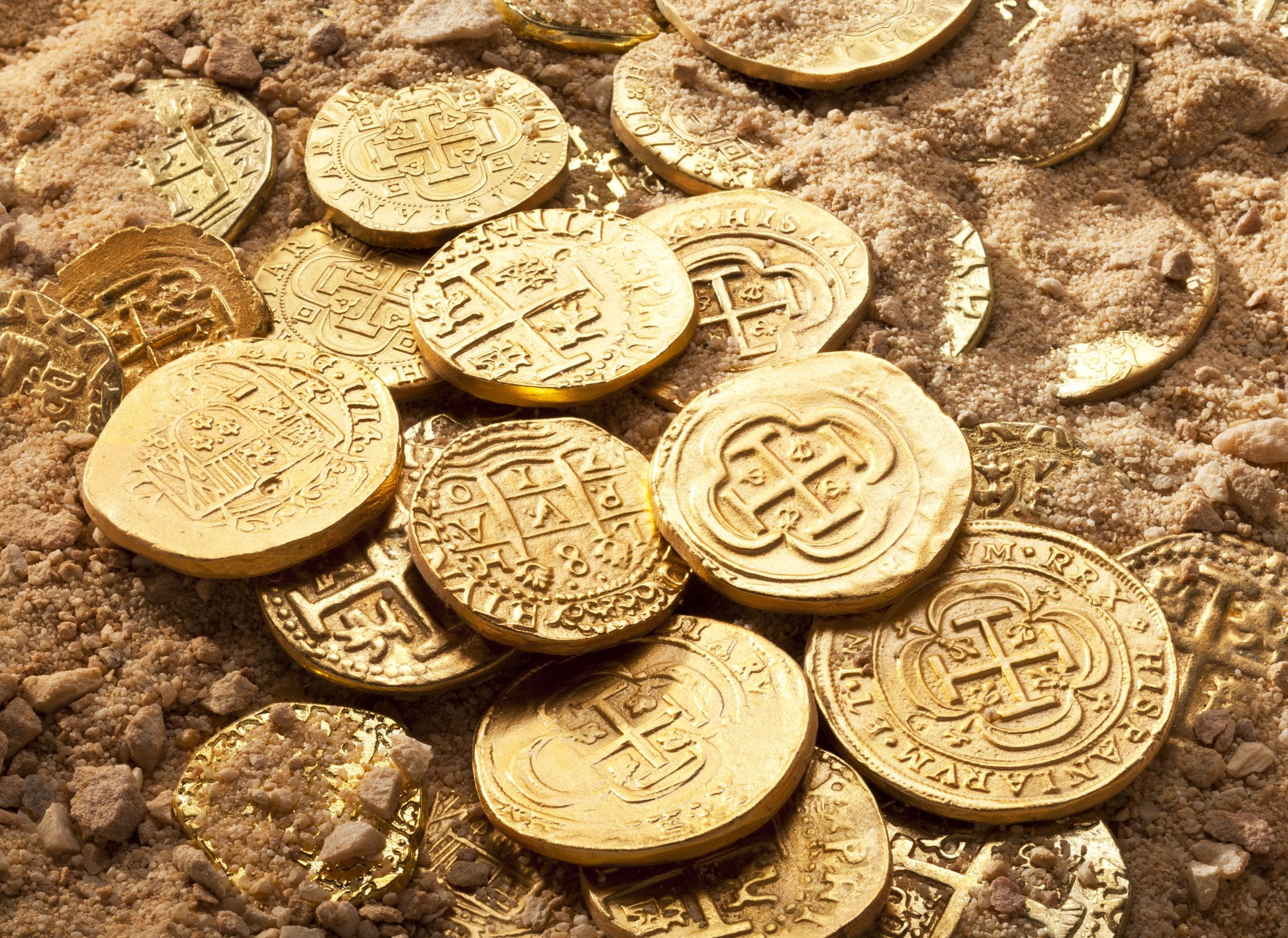 Centuries old variety of gold doubloons and gold cobbs.