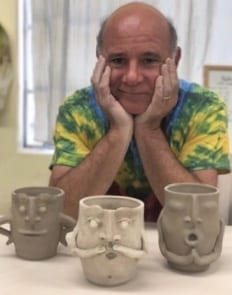 artist with pottery