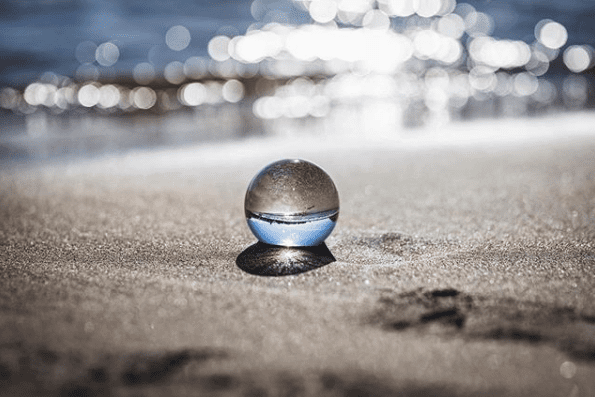 crystal ball in sand