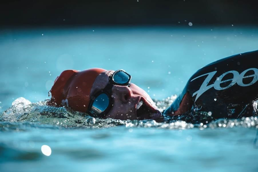 A triathlete coming up for air during a swim