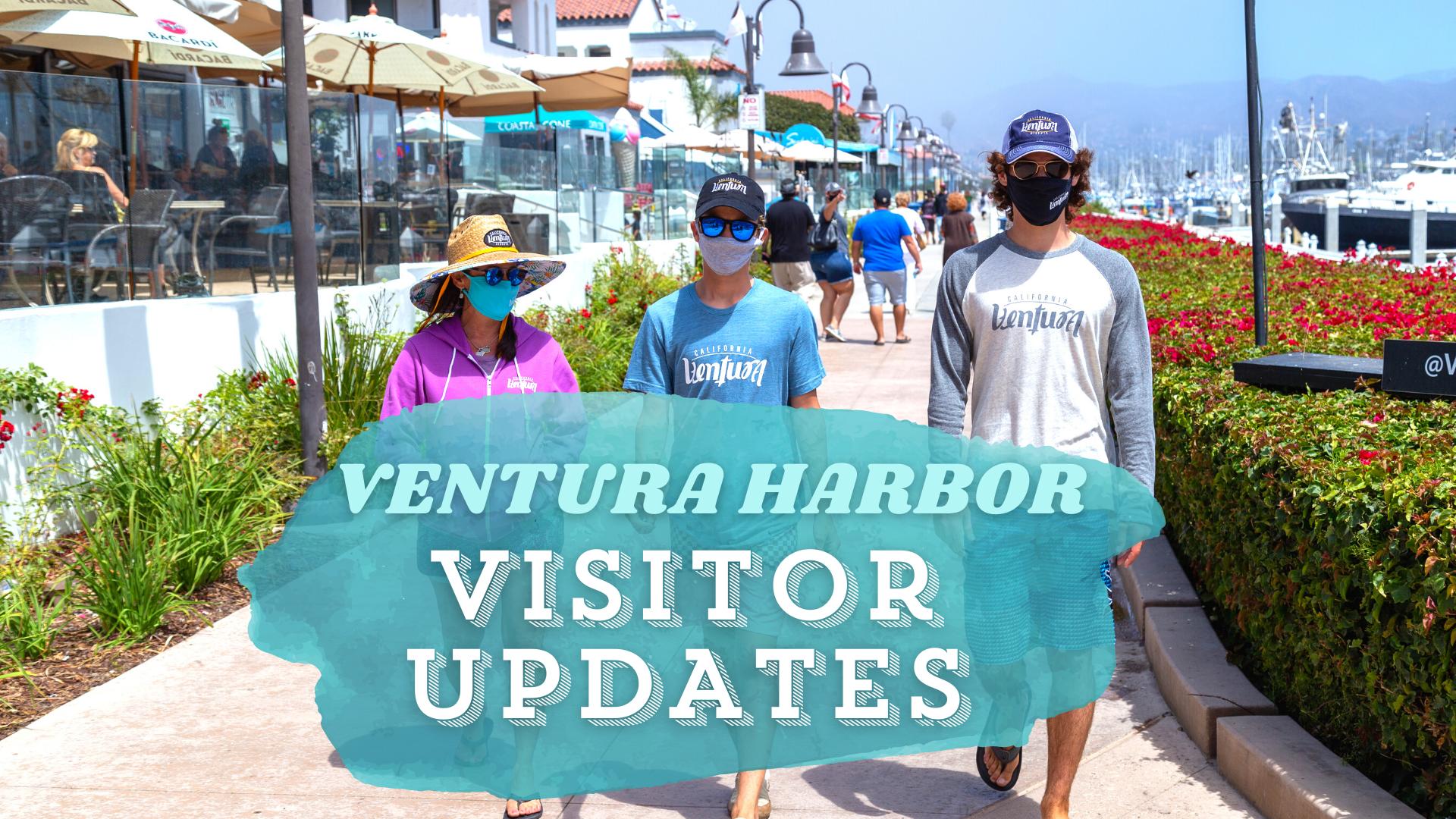 Three people walking on the Ventura Harbor Promenade with masks on