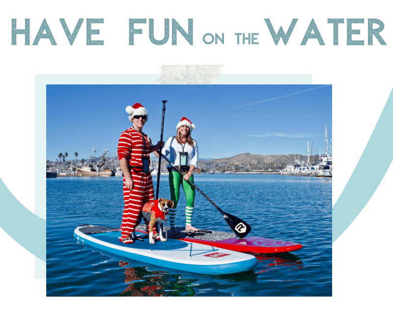 Couple dressed in festive holiday attire on a paddle board