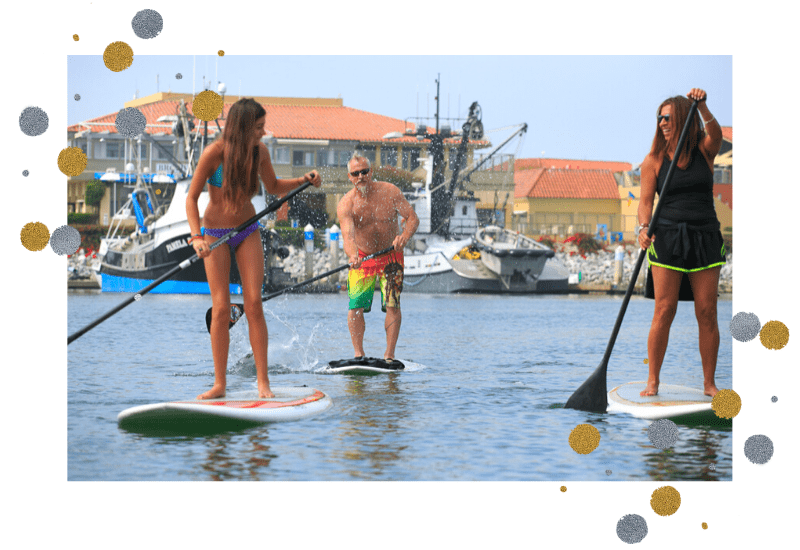 a family is paddle boarding