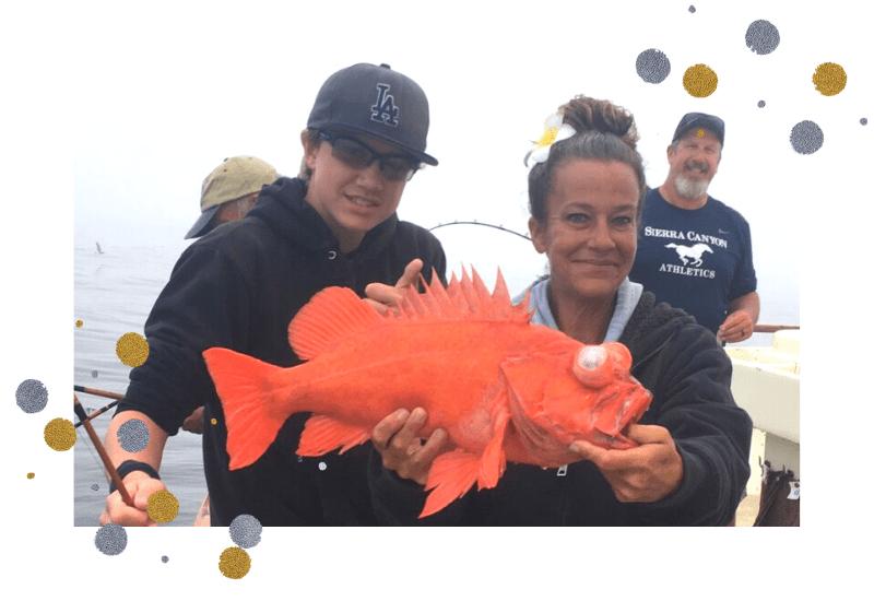 a family caught a big orange fish