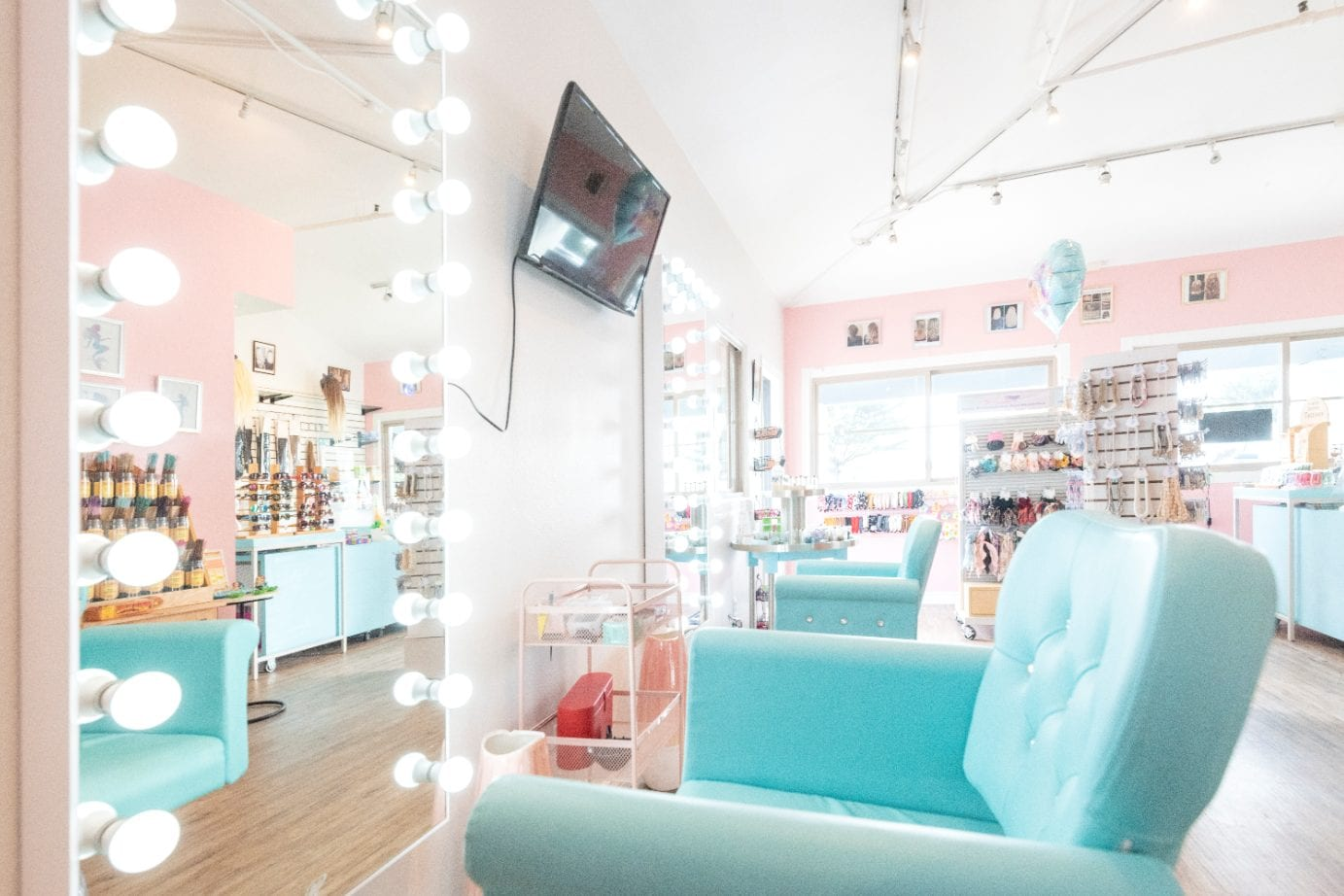 side view of the baby blue chairs and large mirrors