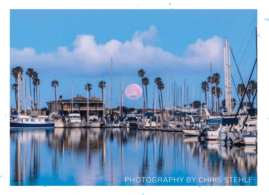 blue moon over the harbor with boats