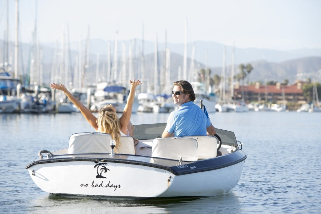 two people happy on a boat