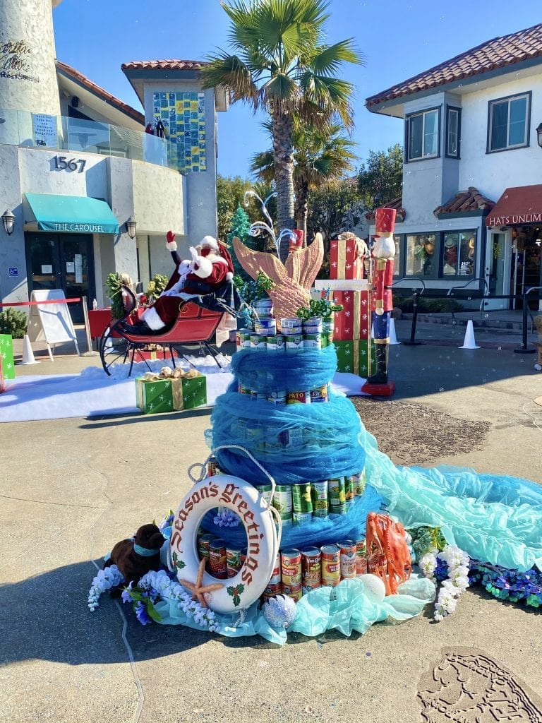 Tree made of cans decorated with a mermaid tail on top