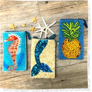 seashore, mermaid tail, and pineapple trinkets