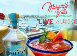 Scenic view of harbor with margarita and graphic that reads margarita villa live music
