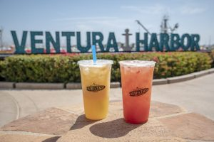 two aguas frescas in front of the ventura harbor sign