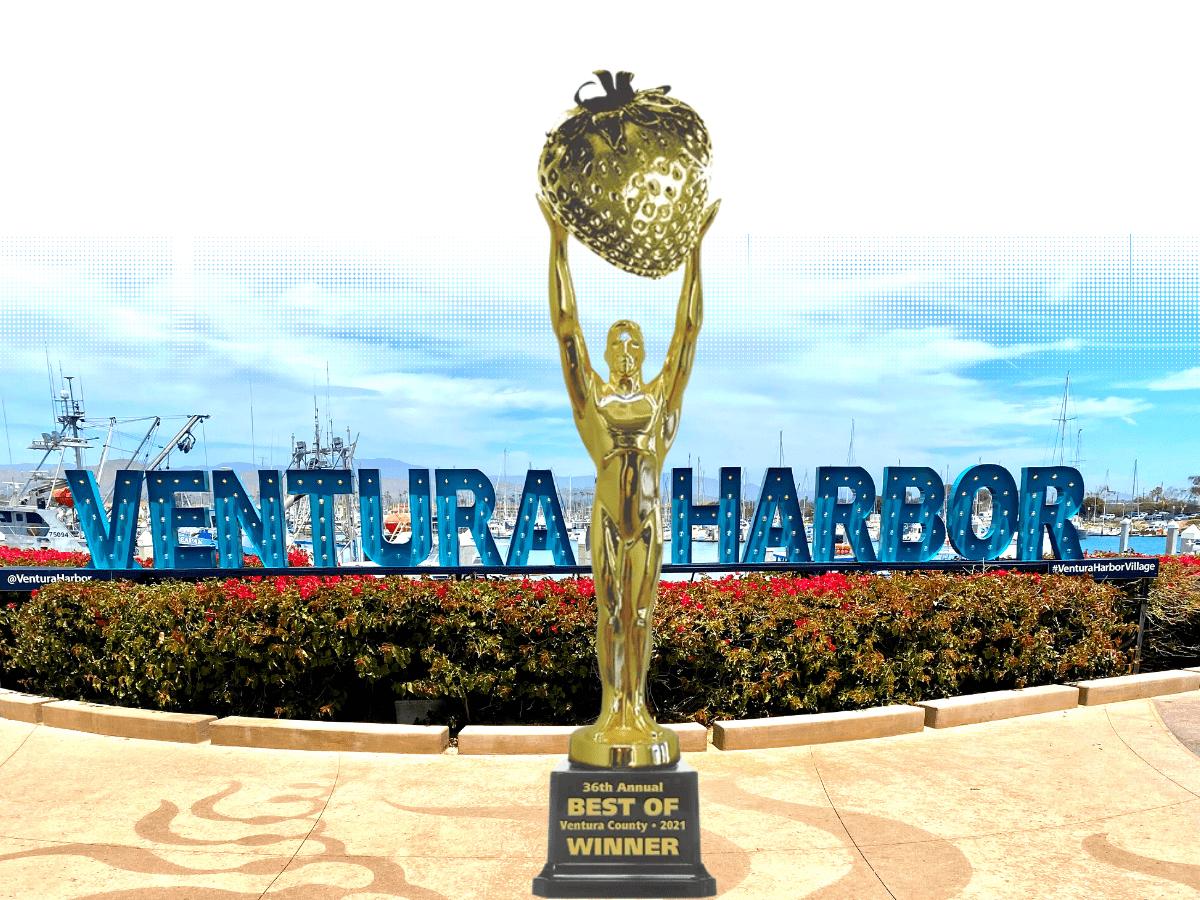 Ventura Harbor promenade with best of statue