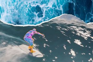 GLITTERY SURFER RIDING A WAVE