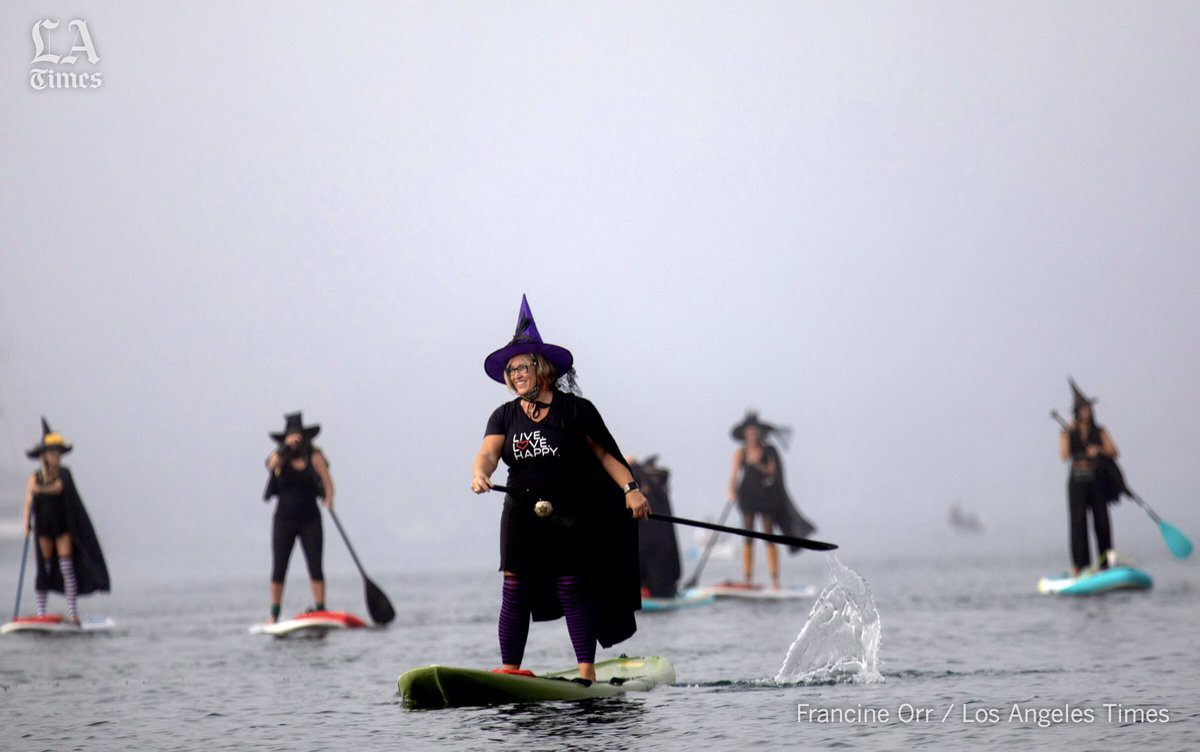 witches on paddle boards
