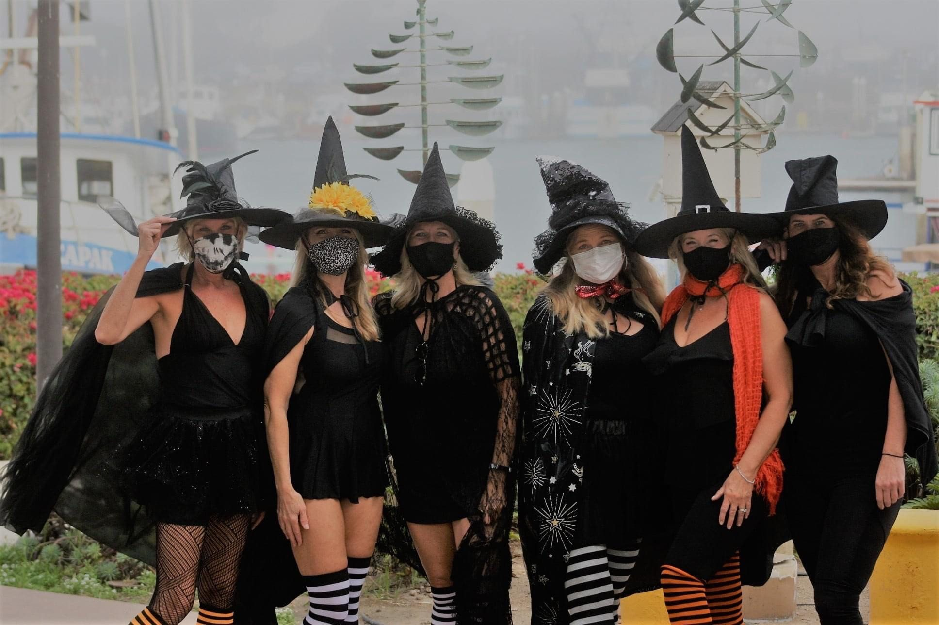 ladies in witch costumes